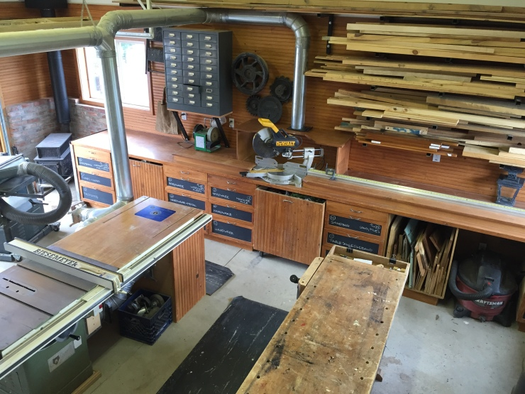 Wood Shop features air filtration, paint booth, wood stove, garage door & much more